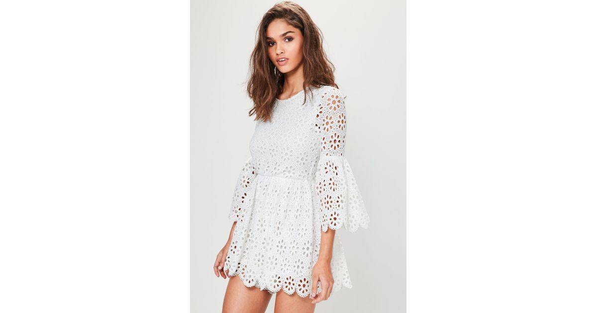 77d6c7354f16 Lyst - Missguided White Crochet Lace Flared Sleeve Playsuit in White