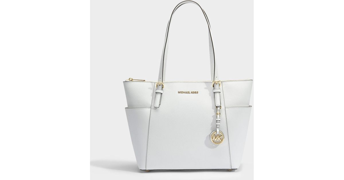 3028e5521f Sac cabas jet set item east-west top zip en cuir saffiano blanc MICHAEL  Michael Kors en coloris Blanc - Lyst