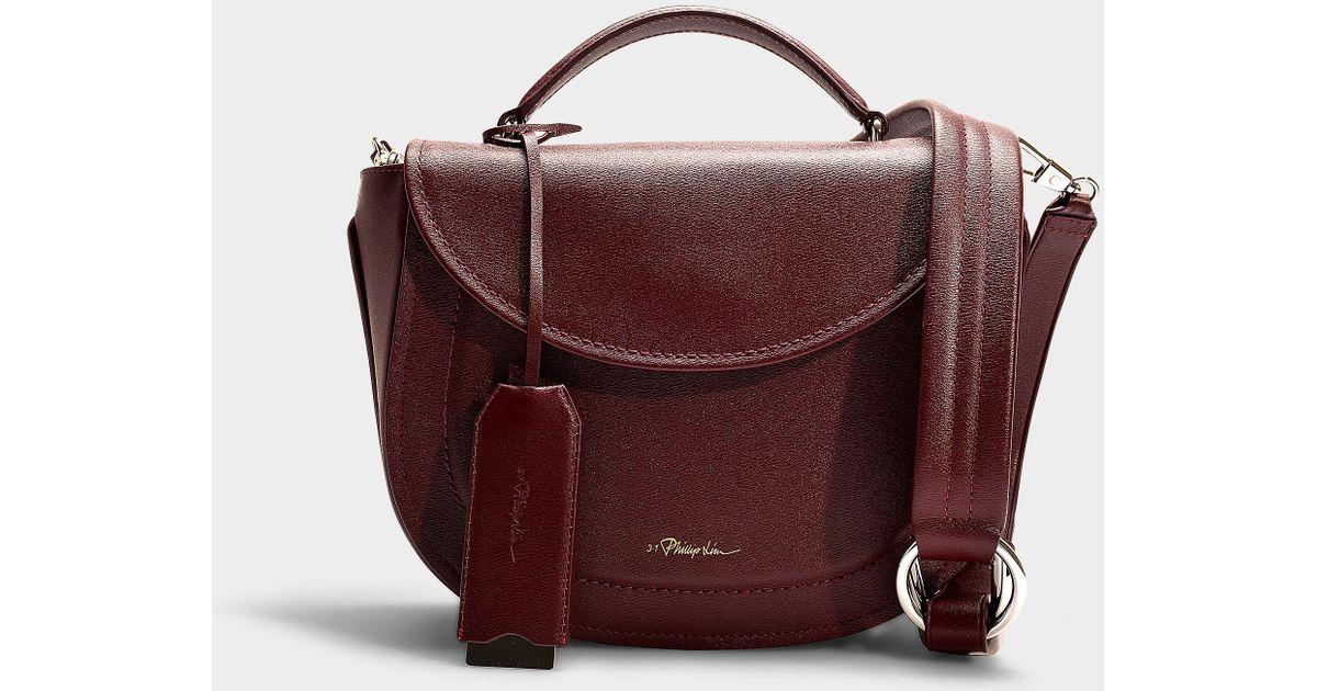 cb1414096550 3.1 Phillip Lim Hudson Top Handle Saddle Bag In Burgundy Calfskin in Purple  - Lyst