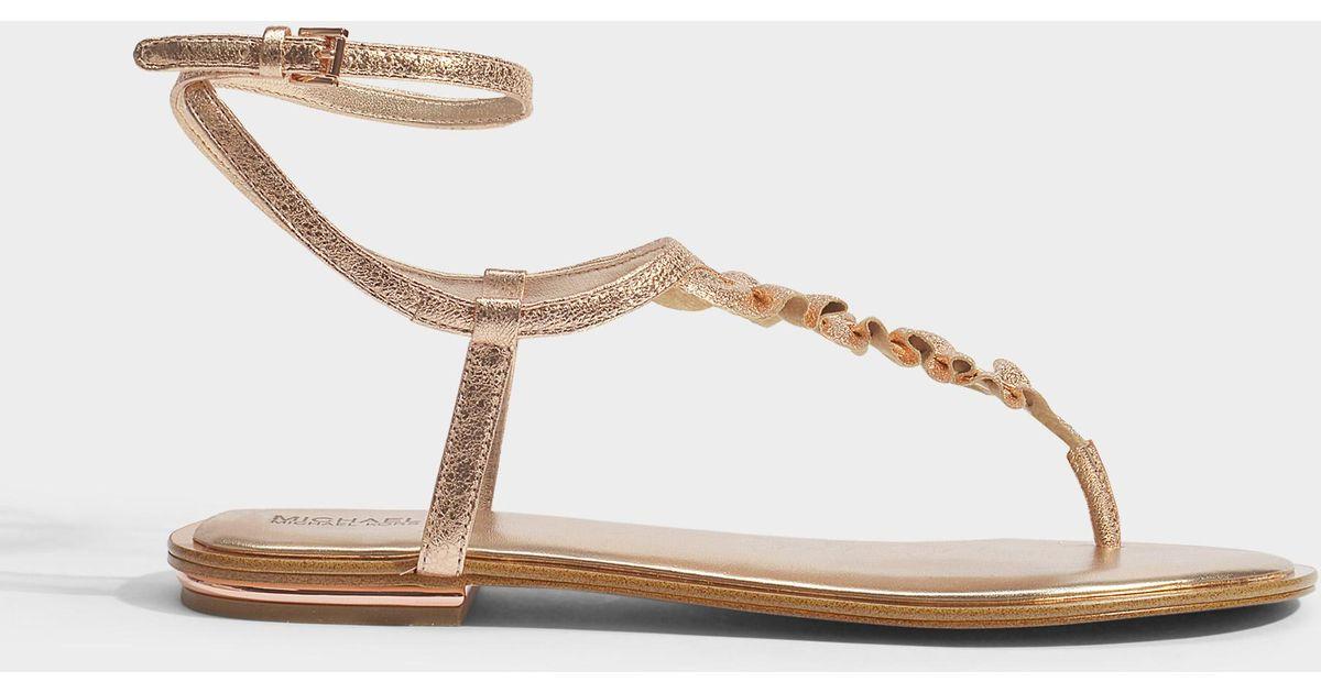 ed8fd00ca240 Michael Kors Bella Metal Pink Thong Sandal in Metallic - Save 18% - Lyst
