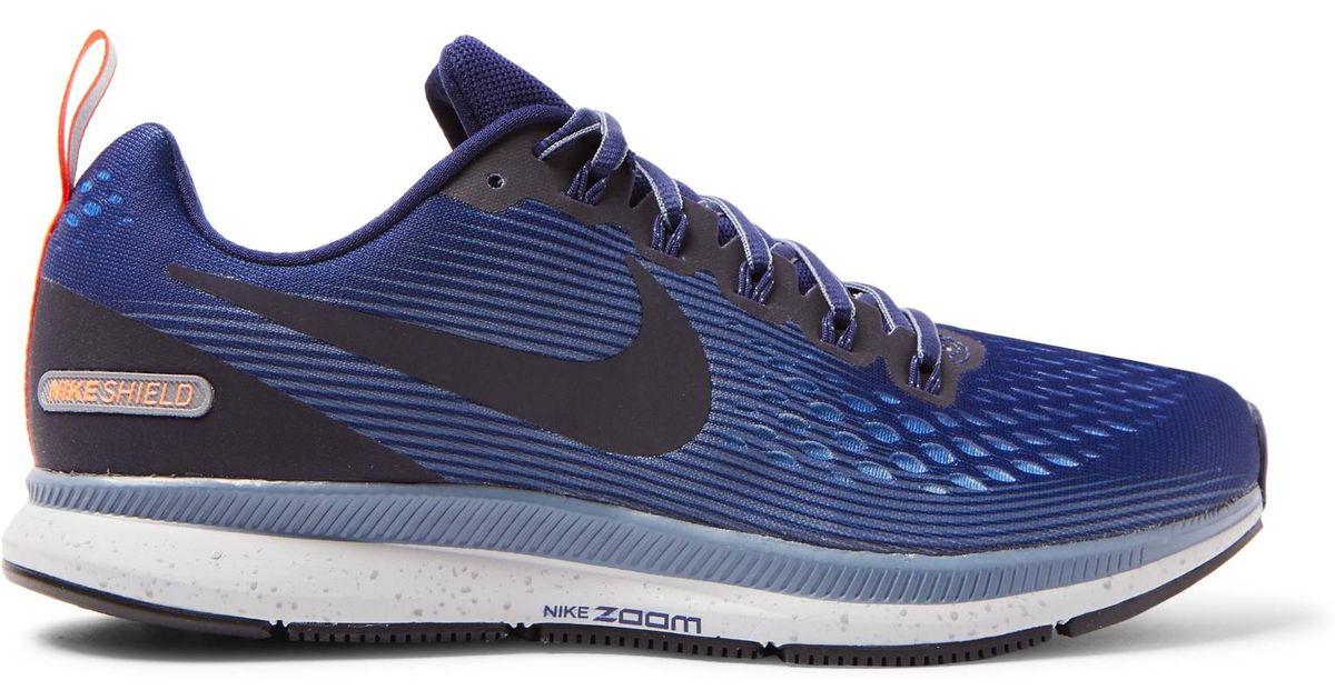 Nike Blue Air Zoom Pegasus 34 Shield Flymesh Sneakers for men