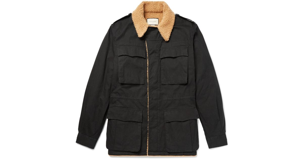 80560ecf3 Gucci Black Faux Shearling-lined Logo-printed Cotton-canvas Jacket for men