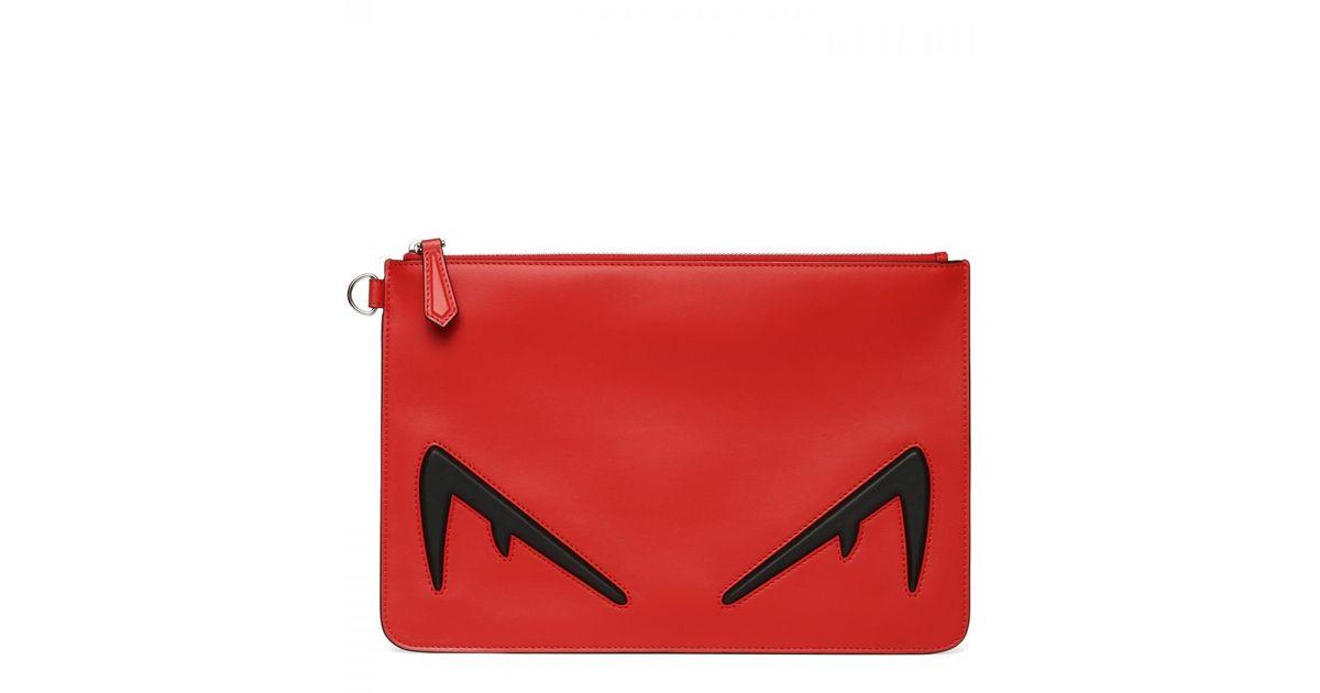 be19f7f3 Fendi Red Eye Embellished Leather Purse for men