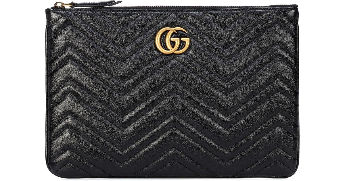 94e5fc78f Pochette GG Marmont en cuir matelassé Gucci en coloris Noir - Lyst