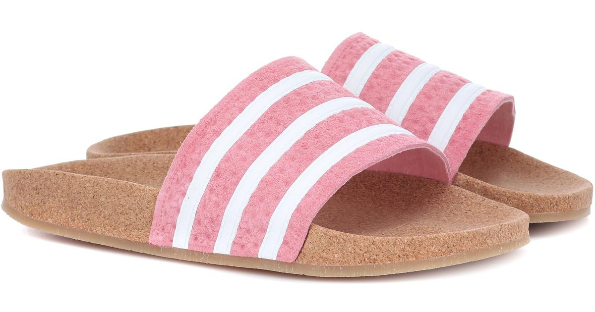 df3f9f663bed ... discount lyst adidas originals adilette suede slides in pink 04d89 4248d