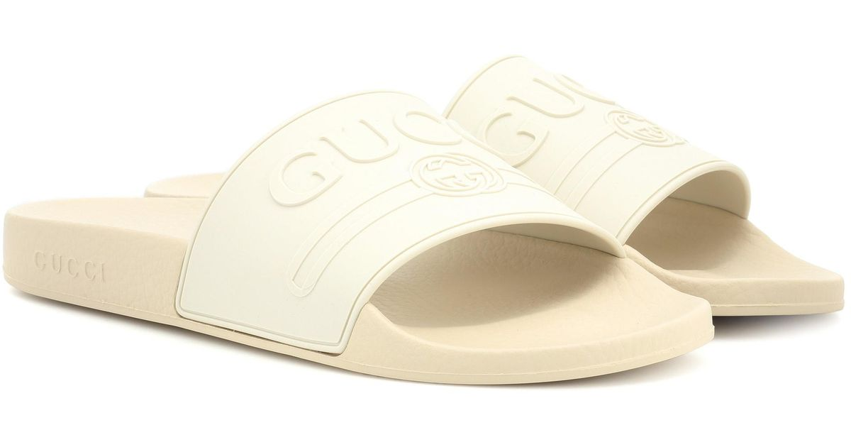 8be08cc405589b Gucci Logo-embossed Slides in White - Lyst