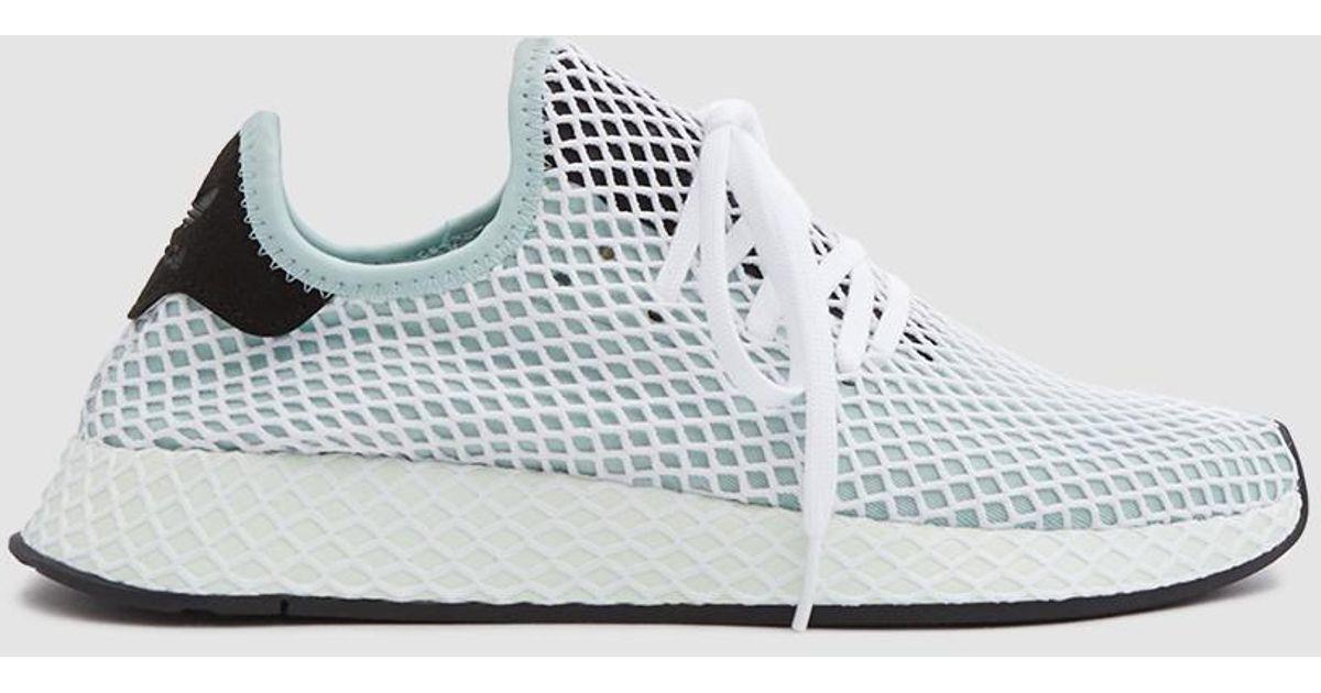 5c493f84d3e7f adidas Deerupt Runner in Green - Lyst