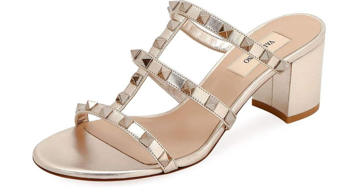 8342cea535a Lyst - Valentino Rockstud Caged Metallic Leather Slide Sandals