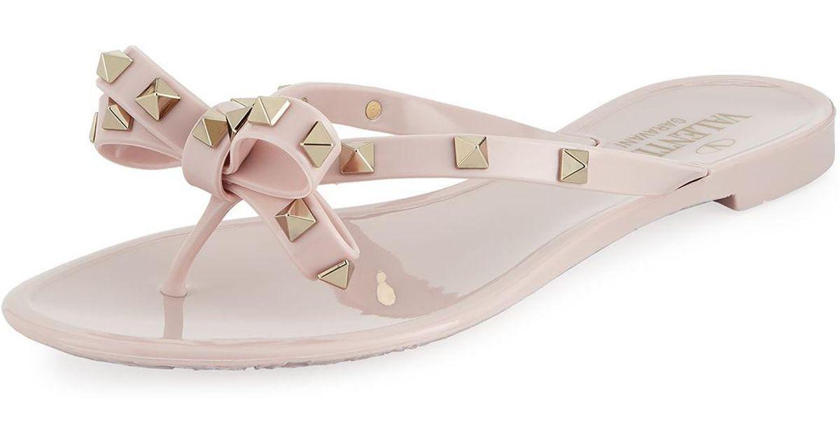 db964f6620c25a Lyst - Valentino Jelly Rockstud Flat Thong Sandals in Pink