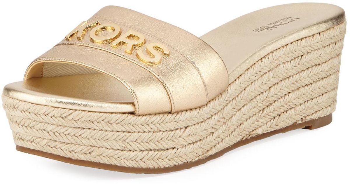 50da0b133530 Lyst - MICHAEL Michael Kors Brady Metallic Logo Platform Sandals in Metallic