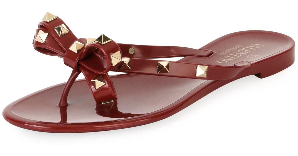 8cfc0994f4f Lyst - Valentino Jelly Rockstud Flat Thong Sandals in Red - Save 19%