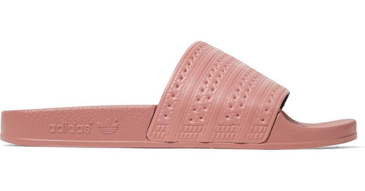 102085f3284 Lyst - adidas Originals Adilette Textured-rubber Slides in Pink