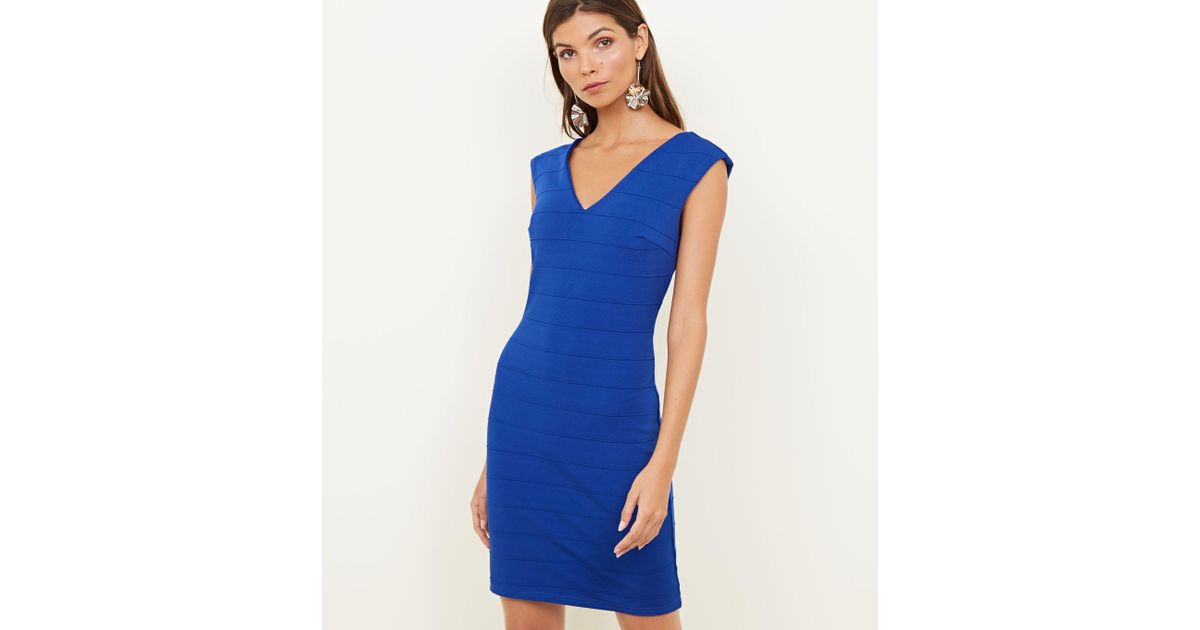 9e0b69bad747 Mela Bright Blue V-neck Bandage Bodycon Dress in Blue - Lyst