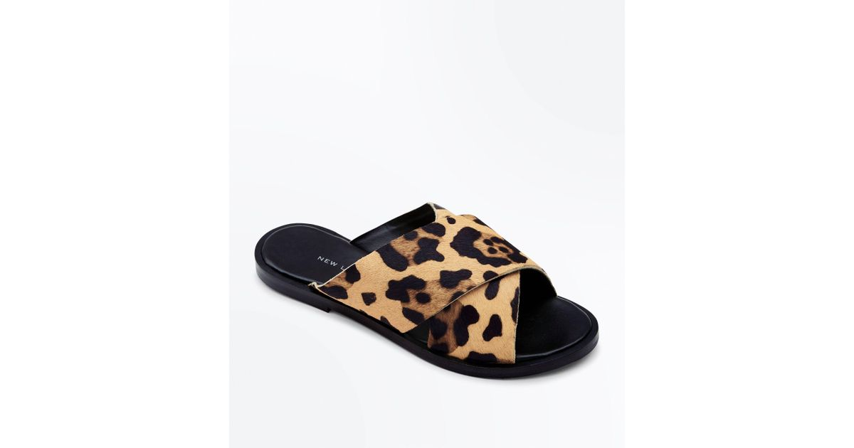 6743dca38557d New Look Wide Fit Stone Leather Leopard Print Sliders in Brown - Lyst