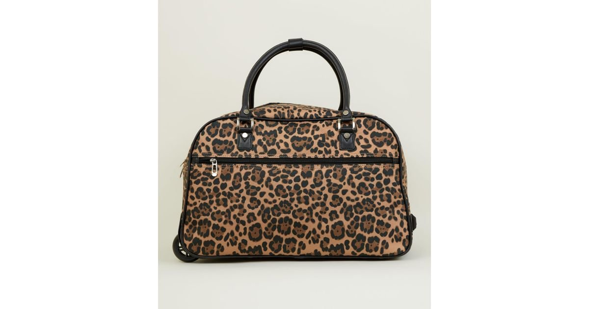 58d9015325d4 New Look Brown Leopard Print Two Wheel Holdall in Brown - Lyst