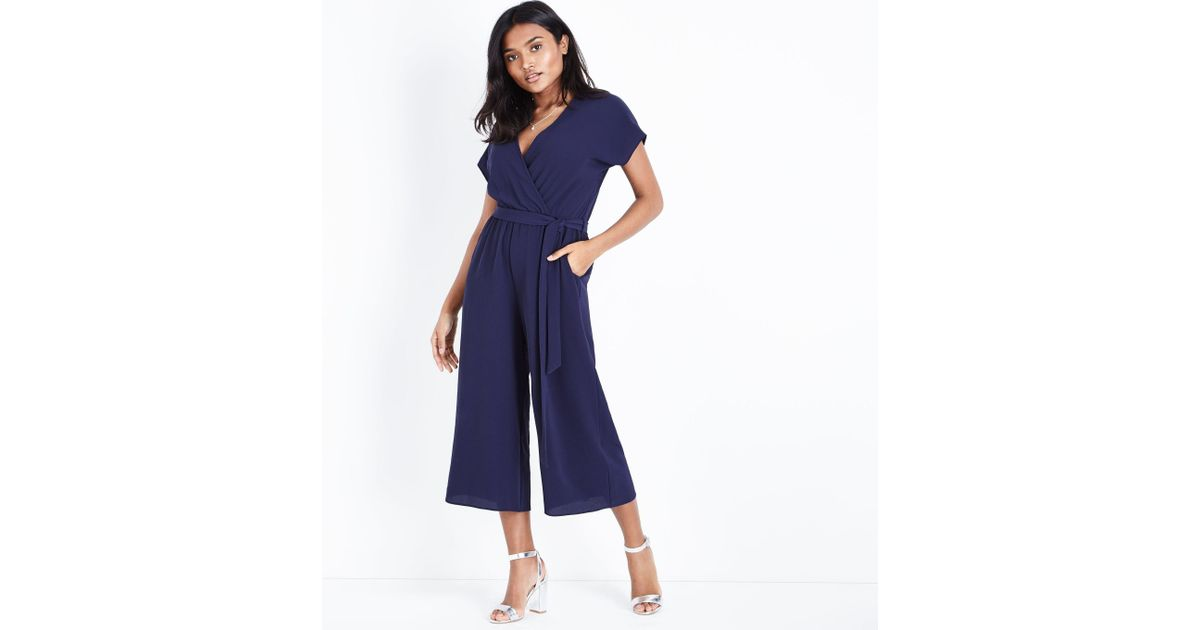 9c0d22ffd42d New Look Petite Navy Wrap Front Belted Culotte Jumpsuit in Blue - Lyst