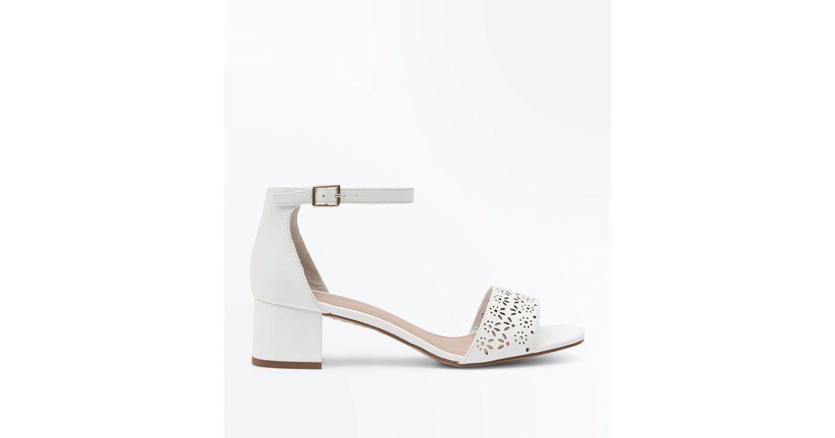 1ce246b63a9 New Look Girls White Laser Cut Block Heel Sandals