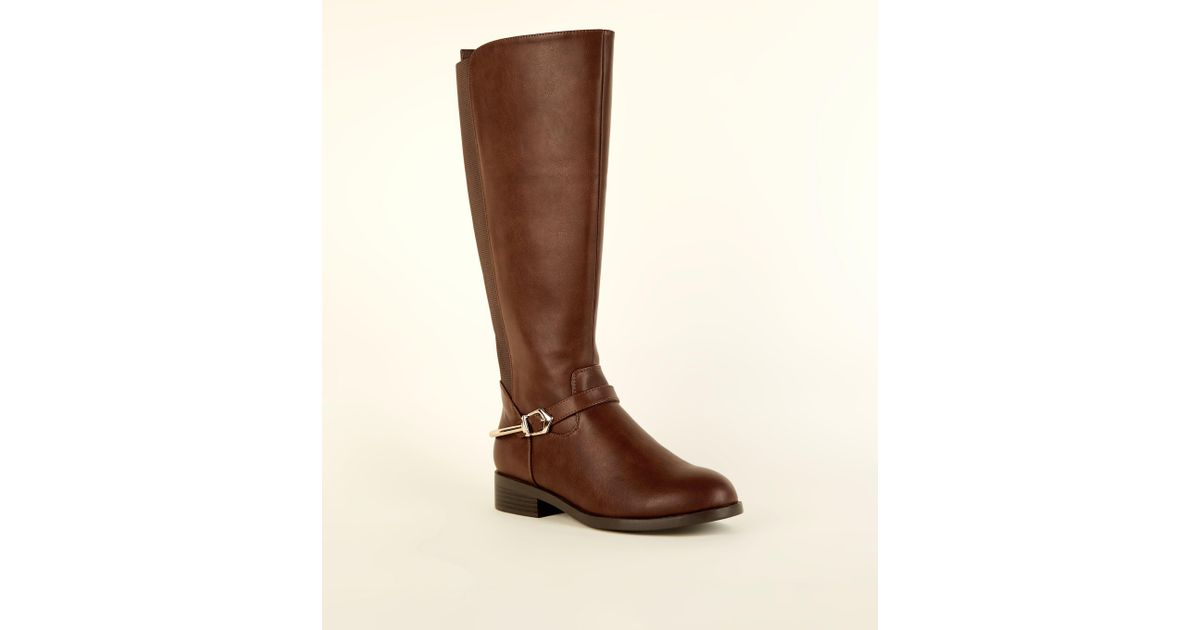 no sale tax sold worldwide look for New Look Denim Wide Fit Tan Metal Stirrup Knee High Boots in Brown ...