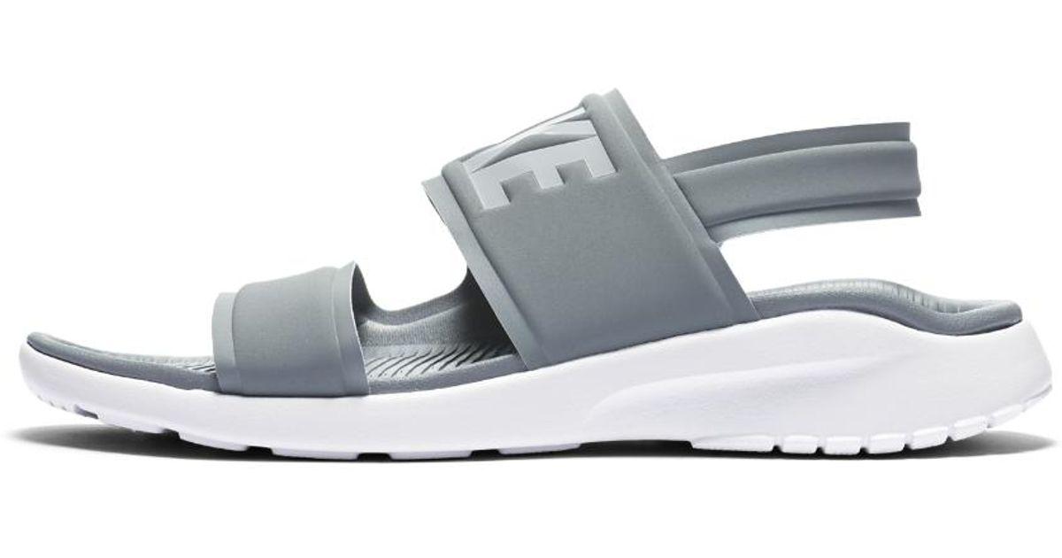 8b492e55a5c9 Lyst - Nike Tanjun Women s Flip Flop in White