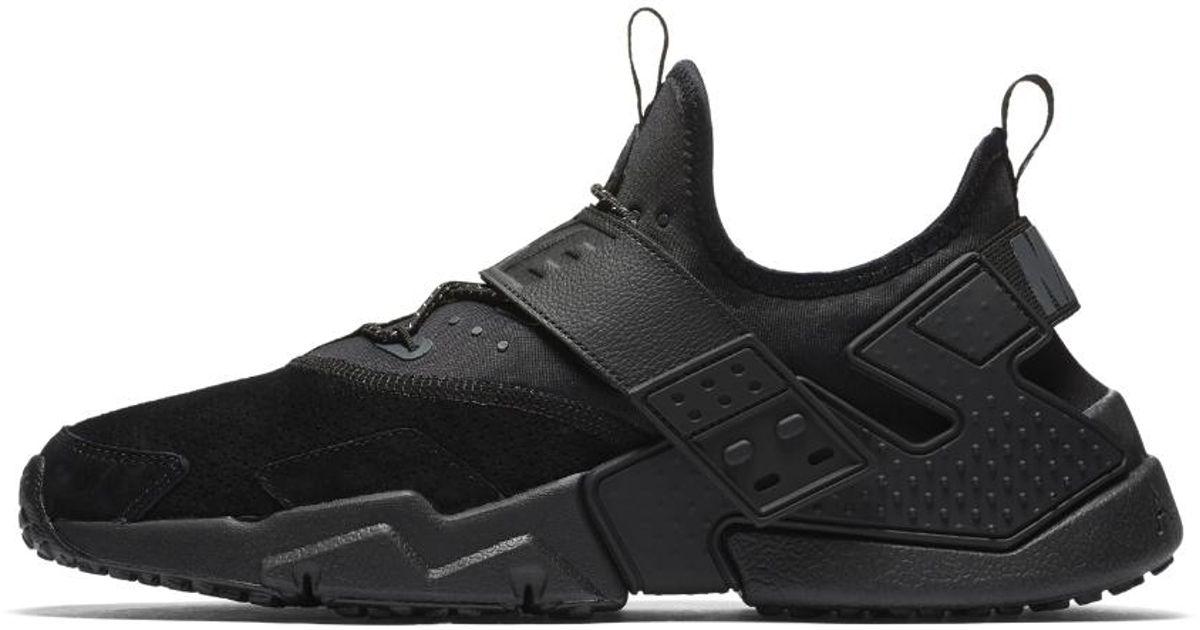 lyst nike air huarache deriva premio delle scarpe maschili in nero per gli uomini.