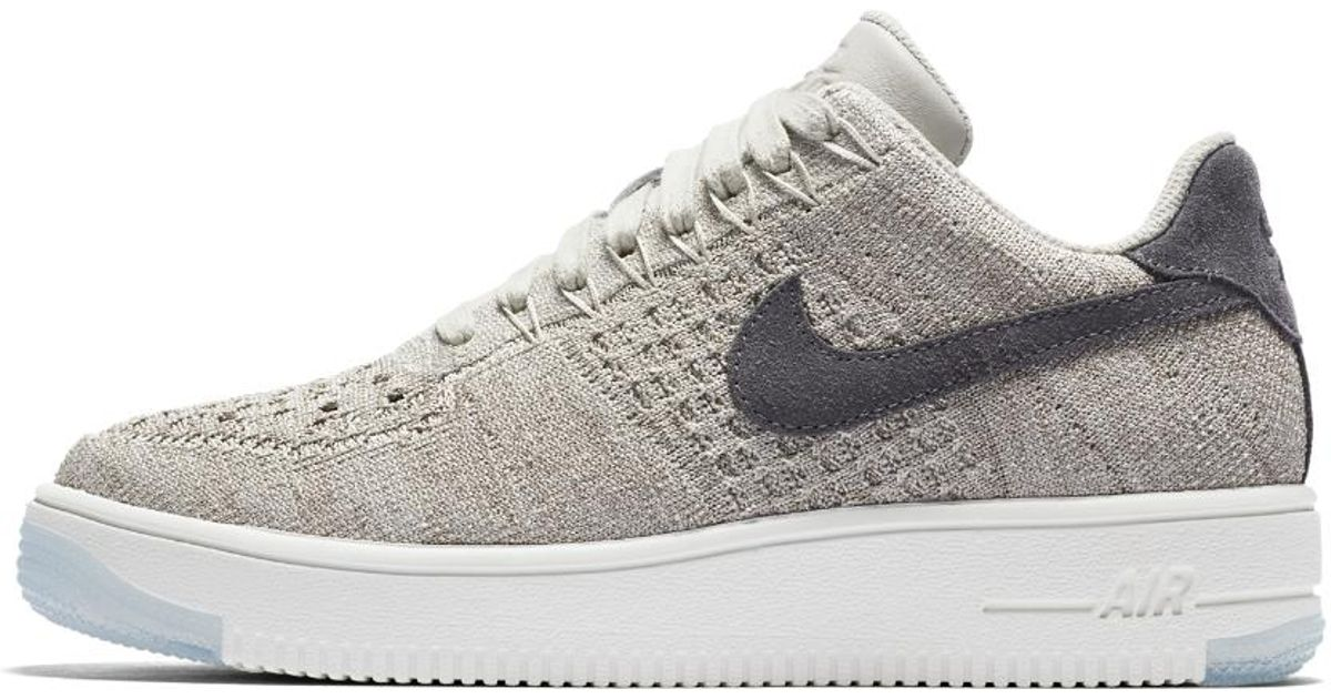 7fd48c10069 Nike Air Force 1 Flyknit Low Women's Shoe in Gray - Lyst