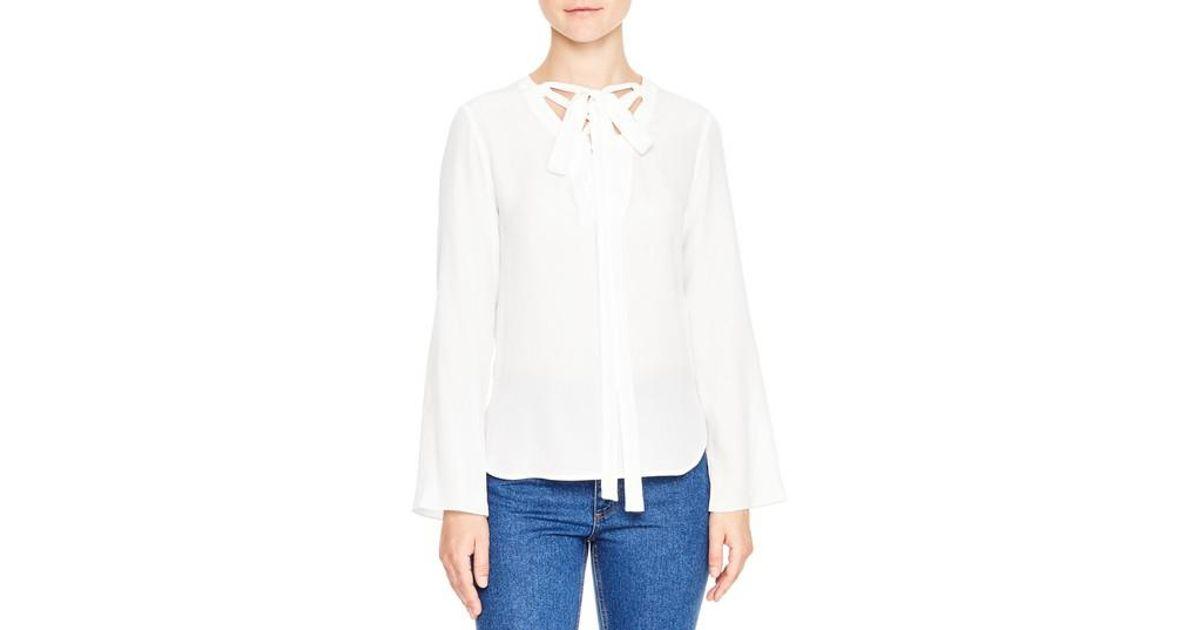 e67b92e3475 Lyst - Sandro Lace-up Tie Silk Top in White