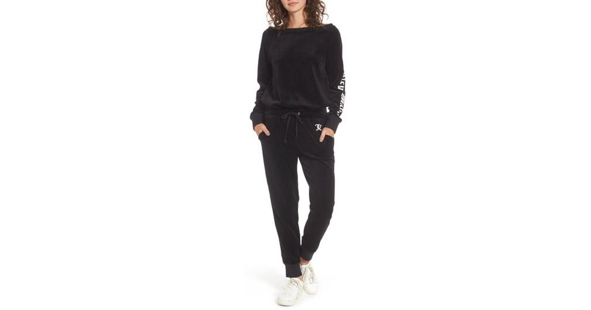 e221d1bdd277 Lyst - Juicy Couture Juicy Mania Velour Track Jumpsuit in Black