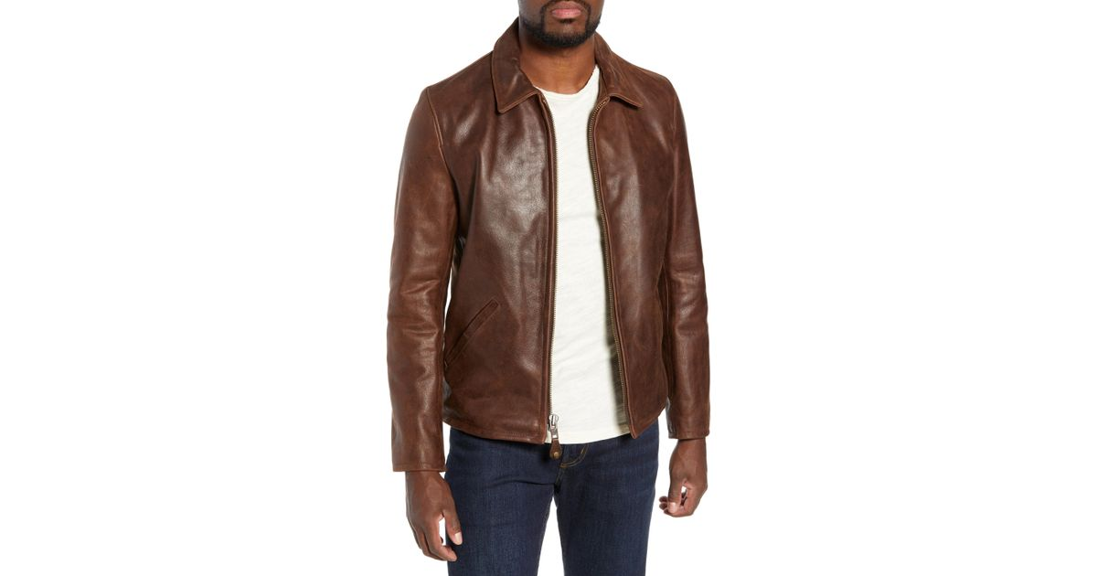 Brown naked leather jacket was and with