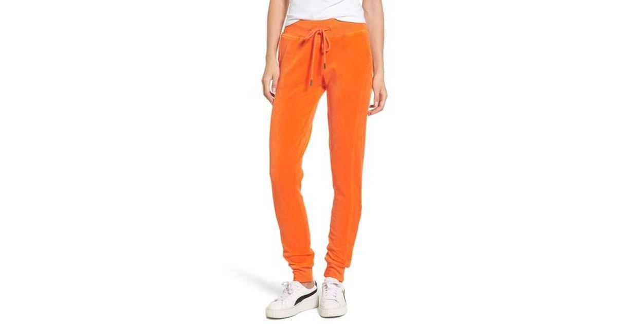21d0322e58 PUMA Orange Puma By Rihanna Velour Track Pants