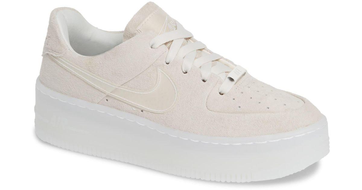 white nike platform shoes