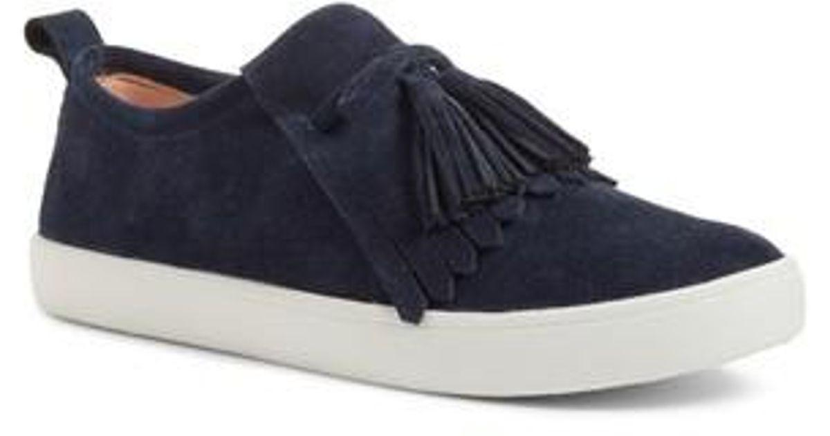 adf4a3d19c23 Lyst - Kate Spade Lenna Tassel Sneaker in Blue