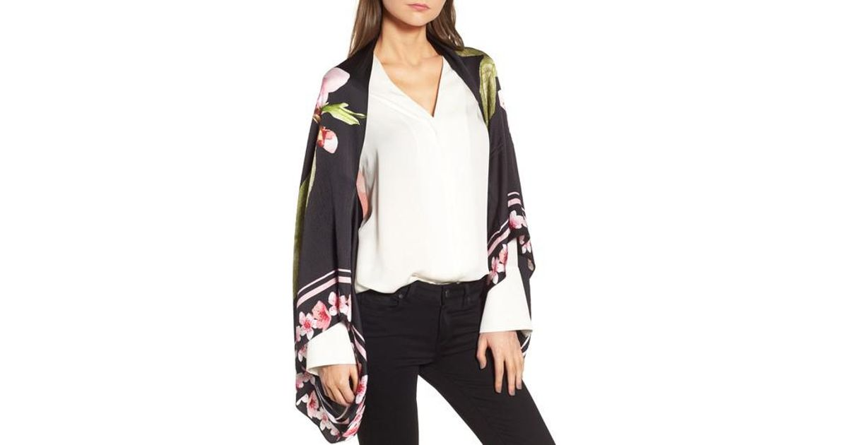 305a311d675558 Lyst - Ted Baker Peach Blossom Silk Cape Scarf in Black