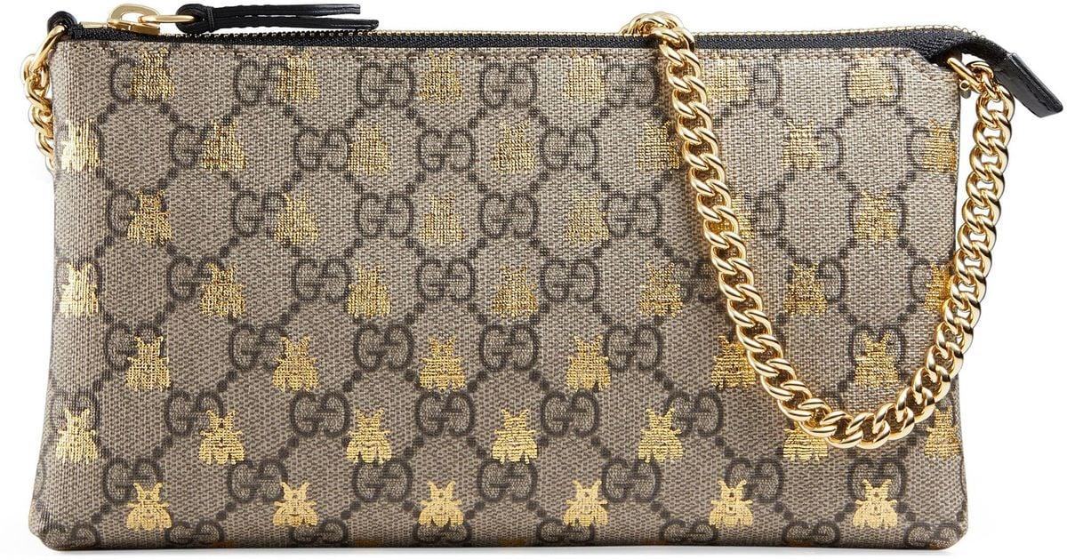 4e96624377d Lyst - Gucci Linea Bee Gg Supreme Wrist Wallet in Natural