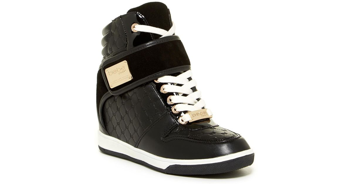 2b4b75ab60d Lyst - Bebe Colby Wedge Sneakers in Black