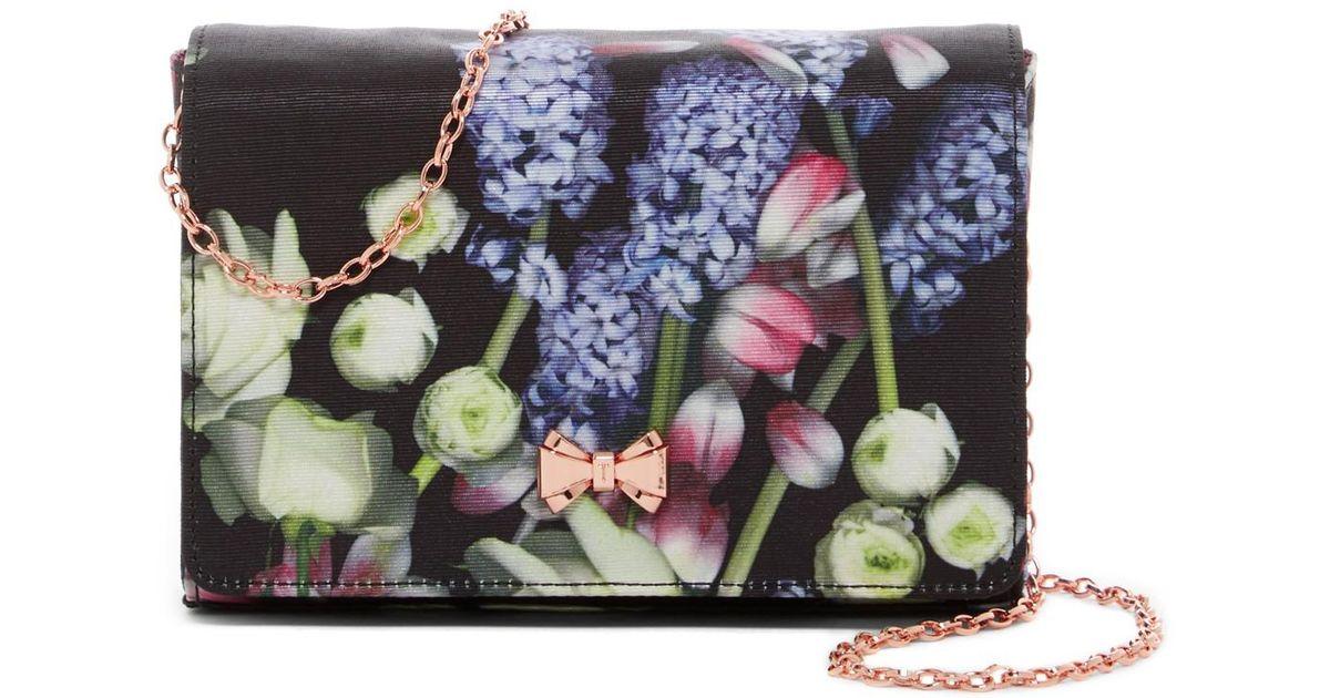 7163103cf Lyst - Ted Baker Kensington Floral Jenniee Bow Evening Bag in Black