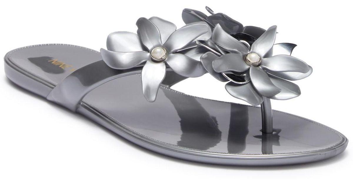 b80331caee1b Lyst - Nine West Mapilo Flower Embellished Jelly Flip Flop (women) in  Metallic