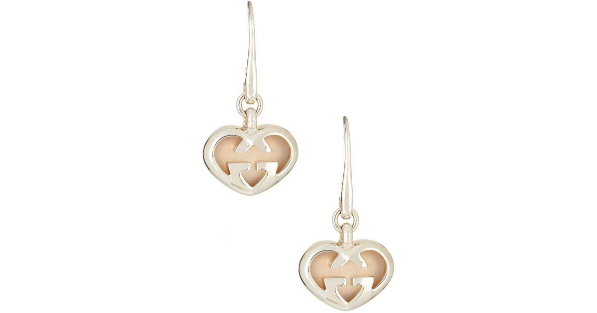 2adbffce654 Lyst - Gucci Sterling Silver Love Britt Earrings in White