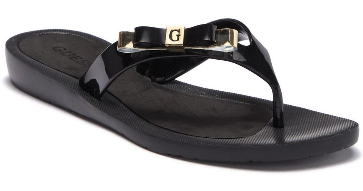 202d592e8a43ef Lyst - Guess Flat Bow Flip Flop in Black