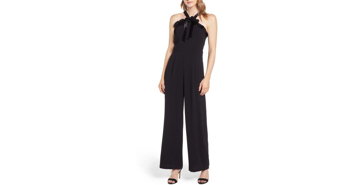 31030bdfe5db Cece by Cynthia Steffe Velvet Bow Detail Jumpsuit in Black - Lyst