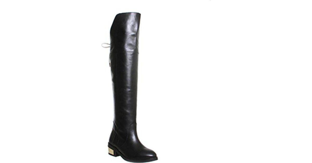Metal Heel Riding Boots In Black
