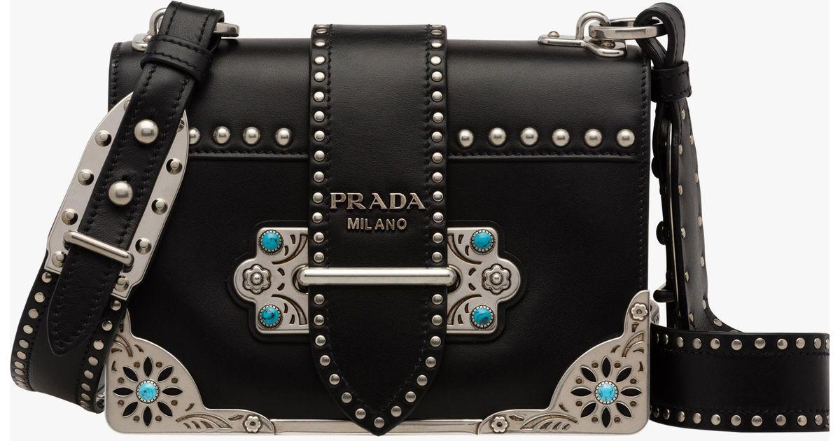 86495c760aea Prada Cahier Studded Calf Leather Bag in Black - Lyst