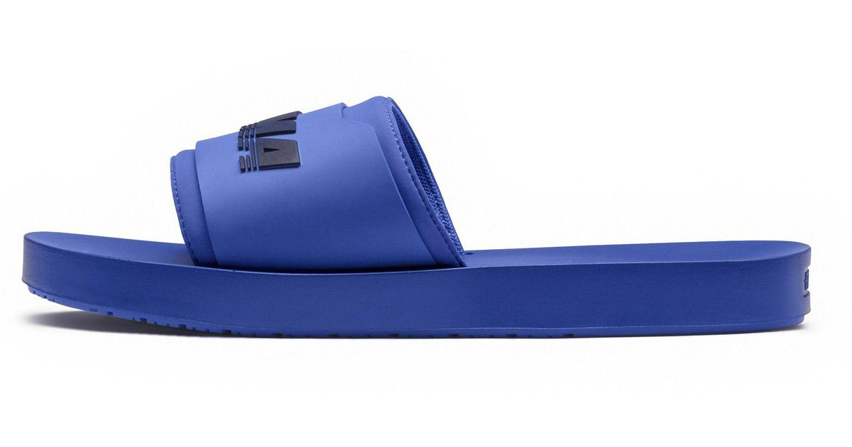 new style bbab0 059b1 PUMA Blue Fenty Surf Slide Mens for men