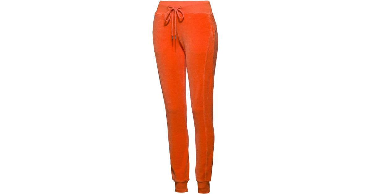 81dc58a355b4 Lyst - PUMA Fenty Women s Velour Fitted Track Pant in Orange
