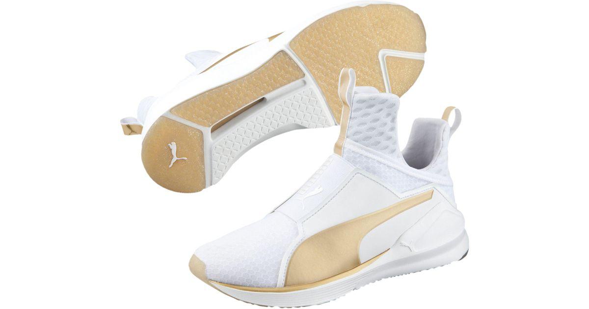 Fierce Gold Women's Training Shoes - Lyst