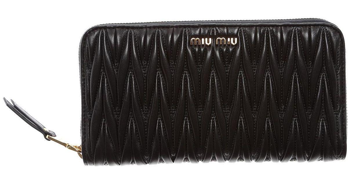mode designer 014ee eea7c Porte-monnaie Femme Miu Miu en coloris Black