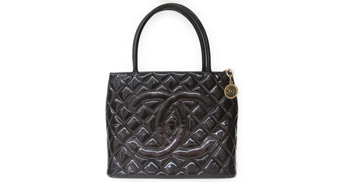 eb1234f45097 Lyst - Chanel Medallion Tote Bag Quilted Patent Leather Brown in Brown