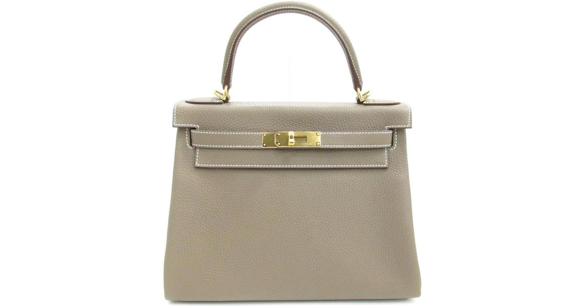 75e65253775a ... closeout lyst hermès kelly 28 handbag 2way shoulderbag togo leather  etoupe gray ghw in gray 5df52 ...