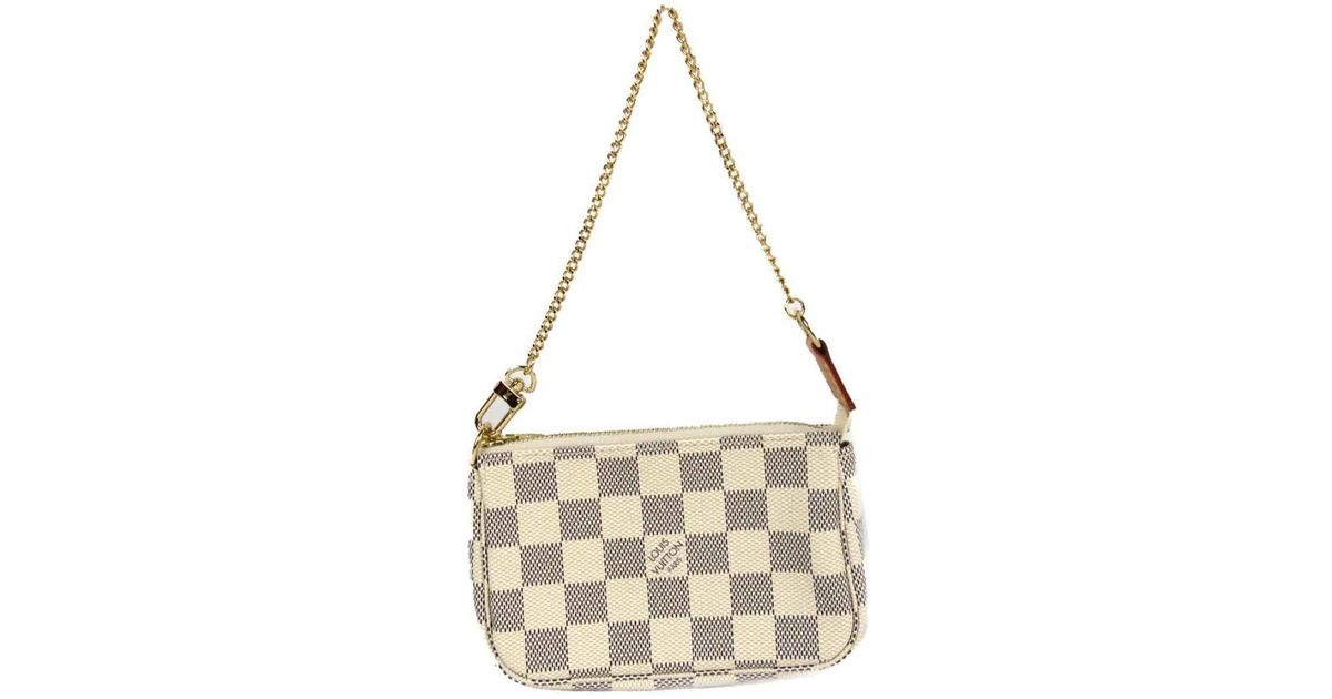 ad7a1451f906 Lyst - Louis Vuitton Mini Pochette Accessory Pouch Bag Damier Azur N58010  in White