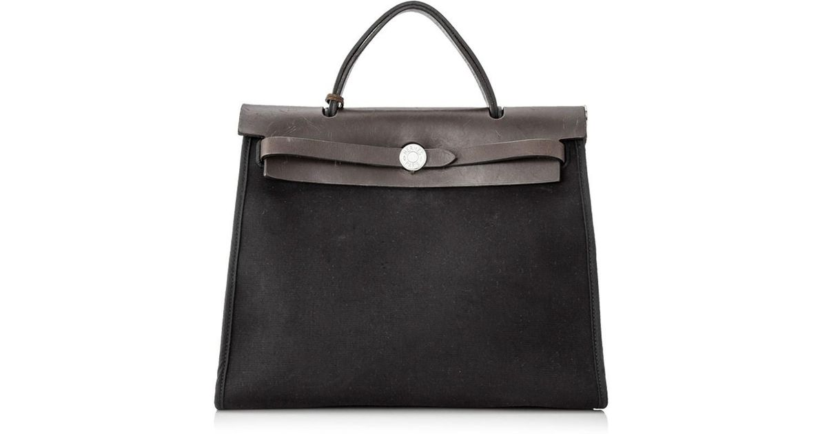 7163b9495c6a Lyst - Hermès Pre-owned Hermés Herbag Zip 31 in Black