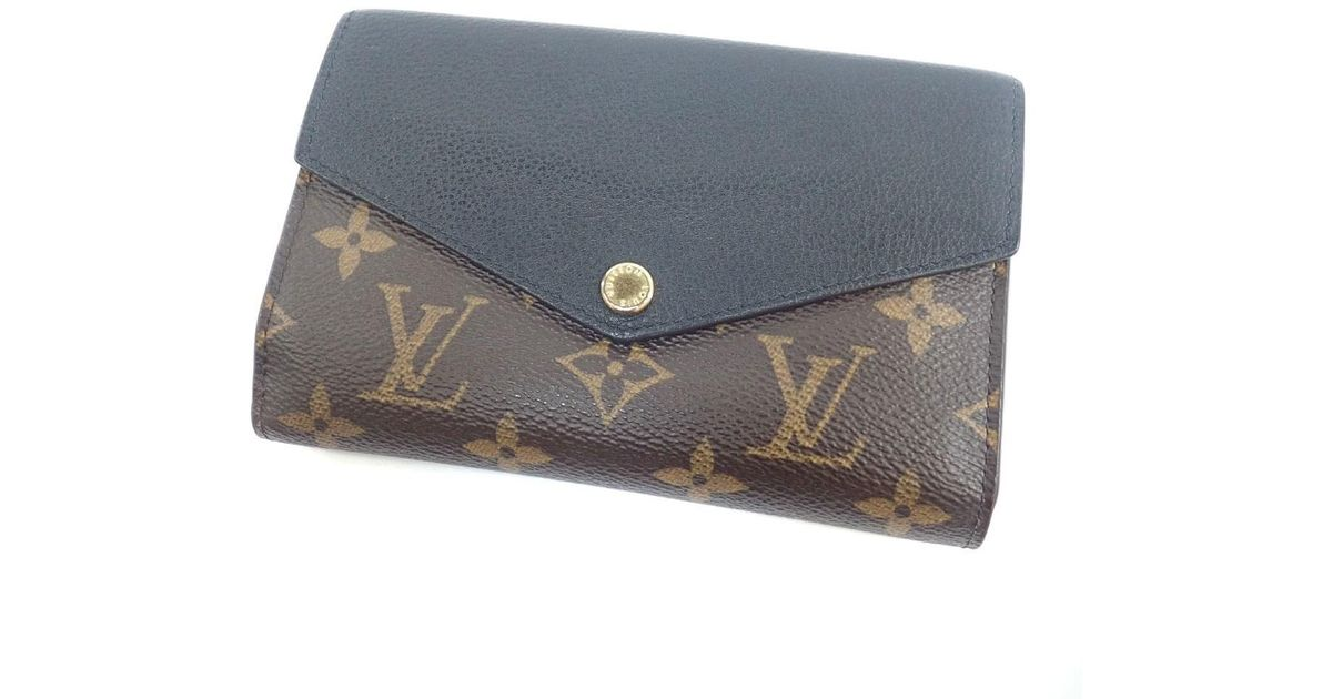reputable site de29b f9750 Louis Vuitton Brown Monogram Canvas Bifold Wallet With Coin Pocket M60990  Portefeiulle · Pallas Compact